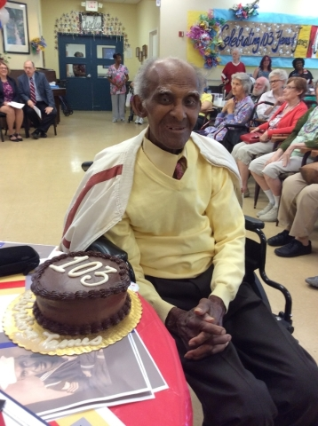James Clark celebrates his 103rd birthday with a vegan chocolate cake donated from Whole Foods Market at Nevada Senior Services' Adult Day Care Center of Las Vegas Aug. 21. (Special to View)