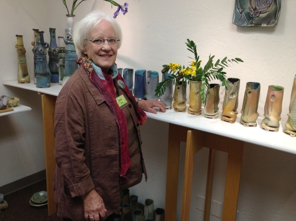 Sandy Blain stands before a display of her work at her Arizona studio on Nov. 15, 2013. She is scheduled to teach a two-day workshop Sept. 5 and 6 in concert with a solo show of her work at Clay A ...