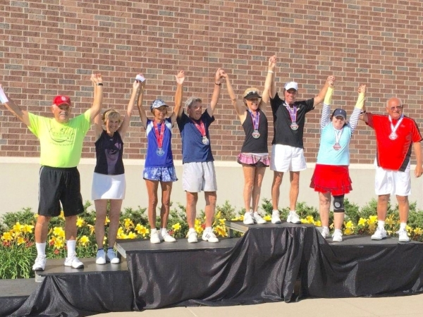 Far left are Larry Scrivner of Las Vegas and Nedra Paschal of Henderson, who won fourth-place ribbons in tennis (ages 70 to 74) at the National Senior Games Association games in 2014 in Minneapoli ...