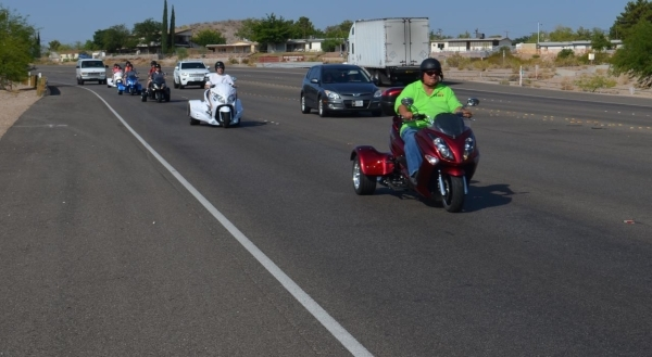 Zion Irizarry leads a Vegas Trike tour to Hoover Dam. The three-wheeled vehicles give drivers the feel of the open road without the skill or license required to ride a motorcycle. (Ginger Meurer/S ...
