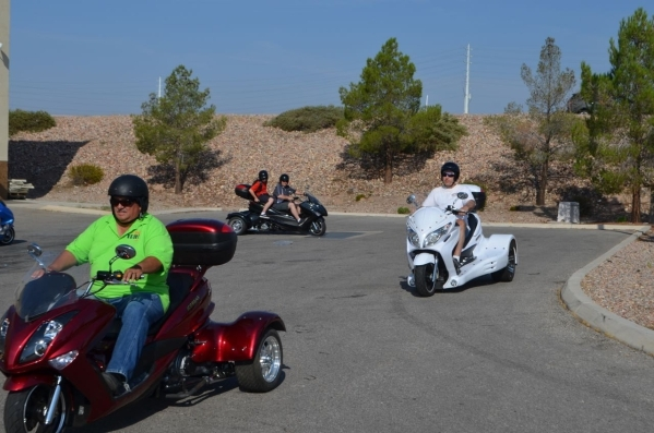 Zion Irizarry leads a Vegas Trike tour group through a quick test drive in a parking lot in Boulder City. (Ginger Meurer/Special to View)