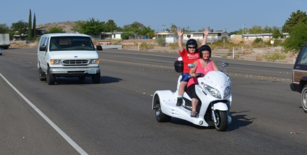 Breandan Legault, 11, raises his hands in the air as his mother, Fiona, drives on a Vegas Trikes tour to Hoover Dam. (Ginger Meurer/Special to View)