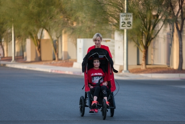 Eden Capsouto pushes her daughter,Taylor Little, in a jogging stroller in preparation for the Rock 'n' Roll Las Vegas Half-Marathon in 2013. (Chase Stevens/View file photo)