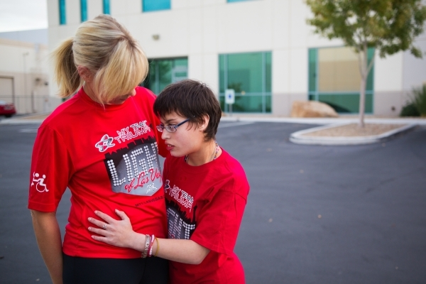 Taylor Little hugs her mother, Eden Capsouto, after a run in preparation for the Rock 'n' Roll Las Vegas Half-Marathon in 2013. (Chase Stevens/View file photo)