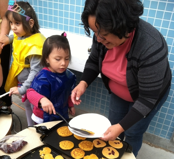Children make pumpkin pancakes at Wynn Elementary School in July 2014 during a Little Books and Little Cooks program. (Courtesy of Nevada  Cooperative Extension).