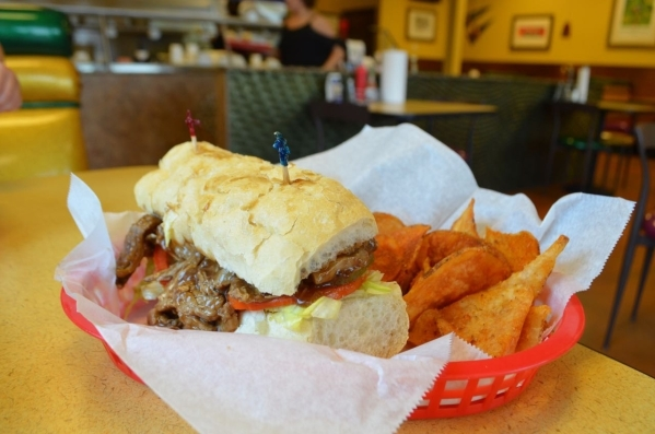The Bourbon Street, a sandwich filled with roast beef covered in gravy and trimmed with lettuce and tomato, is among the entree options at Street Car Po-Boys. (Ginger Meurer/Special to View)