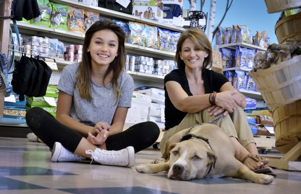 Kendall Stevens and her mother Christy are shown with Rocky at Hearts Alive Village Las Vegas at 1720 S. Rainbow Blvd. on Thursday, Aug. 27, 2015. The adoption center and pet supply store was foun ...