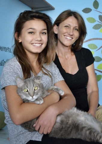 Kendall Stevens, left, and her mother Christy are shown with Izzy at Hearts Alive Village Las Vegas at 1720 S. Rainbow Blvd. on Thursday, Aug. 27, 2015. The adoption center and pet supply store wa ...