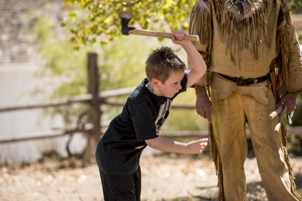 Caiden Strong, 6, throws an axe during Pioneer Day at Spring Mountain Ranch State Park in Blue Diamond, Nev. on Saturday, Sept. 19, 2015. Joshua Dahl/Las Vegas Review-Journal