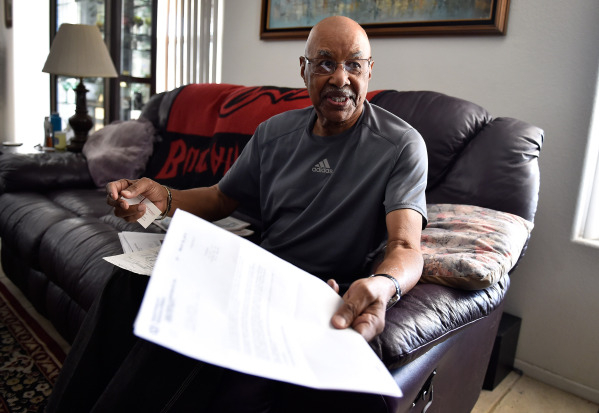 Retired Air Force veteran Willie Smith display a VA letter during an interview at his North Las Vegas home on Monday, Aug. 31, 2015. (David Becker/Las Vegas Review-Journal)