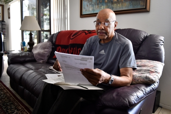 Retired Air Force veteran Willie Smith reviews his VA paperwork during an interview at his North Las Vegas home on Monday, Aug. 31, 2015. (David Becker/Las Vegas Review-Journal)