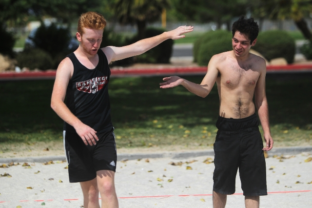 Nik Fava, left, and Josh Quintana high five while playing volleyball at Sunset Park in Las Vegas Sunday, Aug. 30, 2015. Volleyball players are upset about the Clark County Parks and Recreation Dep ...
