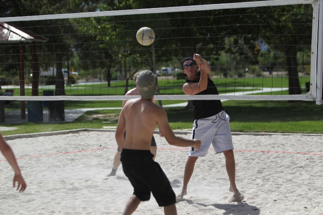 Chris Fava hits the ball over the net while playing volleyball at Sunset Park in Las Vegas Sunday, Aug. 30, 2015. Volleyball players are upset about the Clark County Parks and Recreation Departmen ...