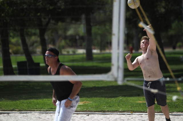 Sean Lawlor, right, serves the ball while playing volleyball with Chris Fava at Sunset Park in Las Vegas Sunday, Aug. 30, 2015. Volleyball players are upset about the Clark County Parks and Recrea ...