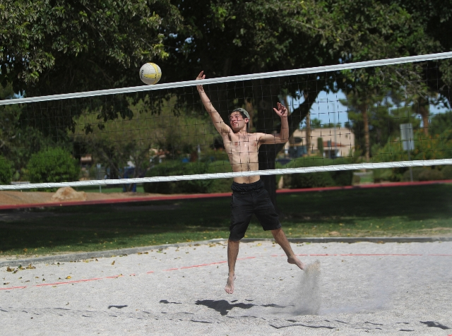 Josh Quintana hits the ball over the net while playing volleyball at Sunset Park in Las Vegas Sunday, Aug. 30, 2015. Volleyball players are upset about the Clark County Parks and Recreation Depart ...