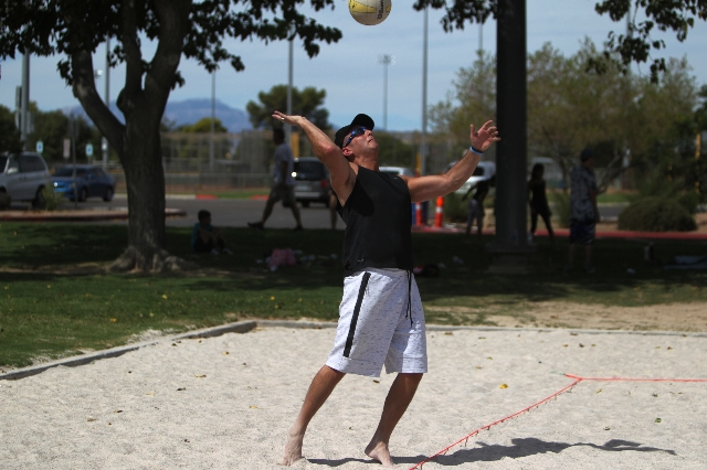 Chris Fava gets ready to serve the ball while playing volleyball at Sunset Park in Las Vegas Sunday, Aug. 30, 2015. Volleyball players are upset about the Clark County Parks and Recreation Departm ...