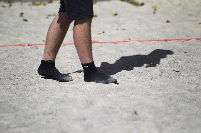 Sean Lawlor plays volleyball wearing socks at Sunset Park in Las Vegas Sunday, Aug. 30, 2015. Volleyball players are upset about the Clark County Parks and Recreation Department's move to pu ...