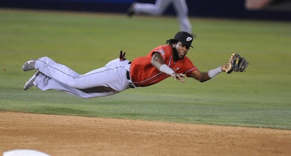 El Paso Chihuahuas shortstop Hector Gomez makes a diving catch to rob Las Vegas 51s' Dilson Herrera of a base hit in the third inning of their Triple-A minor league baseball game at Cashman  ...