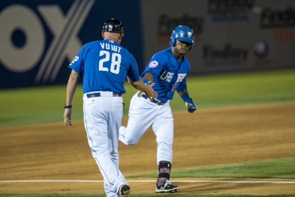 Dilson Herrera of the Las Vegas 51's gives coach Jack Voigt a high five after hitting a home run against the Tacoma Rainers at Cashman Field on Friday, Sept. 4, 2015. (Joshua Dahl/Las Vegas  ...