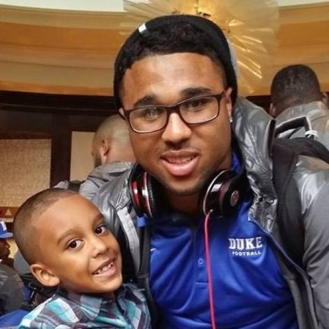 Former Bishop Gorman High star and now Duke senior running back Shaquille Powell hangs out with his brother, Malachi Briggs, following a Blue Devils game last season. Briggs, 7, died from kidney c ...
