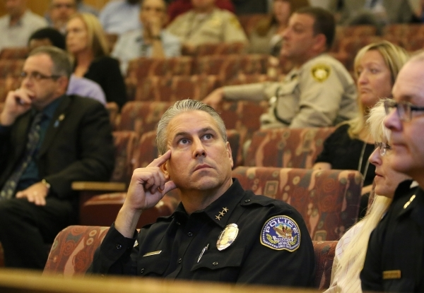Henderson Police Deputy Chief Todd Peters, center, attends a public hearing for More Cops sales tax at of a County Commission meeting at the commission chambers Tuesday, Sept. 1, 2015, in Las Vega ...