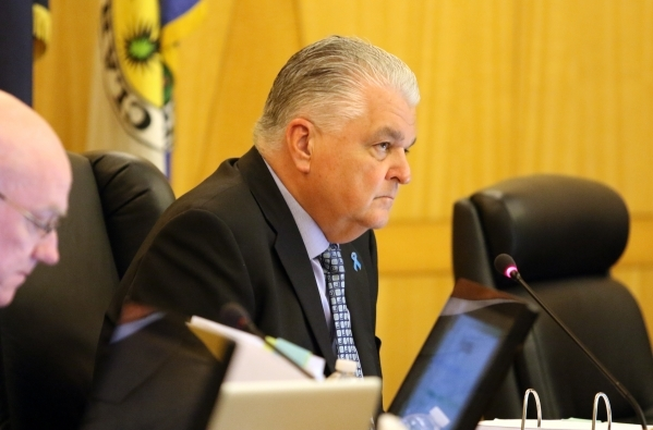 Commissioner Steve Sisolak, chairman, listens to public hearing for More Cops sales tax at of a County Commission meeting at the commission chambers Tuesday, Sept. 1, 2015, in Las Vegas. Ronda Chu ...