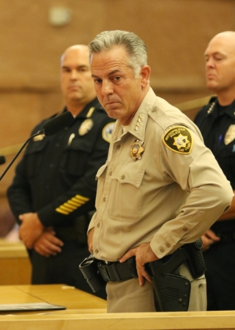 Clark County Sheriff Joseph Lombardo, front, is shown with Henderson Police Chief Patrick E. Moers, left, and Mesquite Police Chief Troy Tanner, during a public hearing for More Cops sales tax at  ...