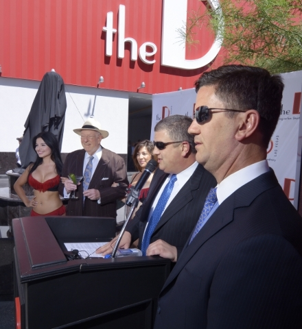 """Derek Stevens, at microphone, and his brother Greg, right, co-owners of the D hotel-casino, are shown during an unveiling event for a replica statue called """"Manneken Pis,"""" Dutch for &quo ..."""