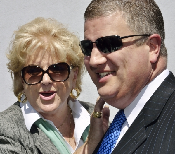 "Derek Stevens, co-owner of the D hotel-casino, is shown with Las Vegas Mayor Carolyn Goodman during an unveiling event for a replica statue called ""Manneken Pis,"" Dutch for ""Little  ..."