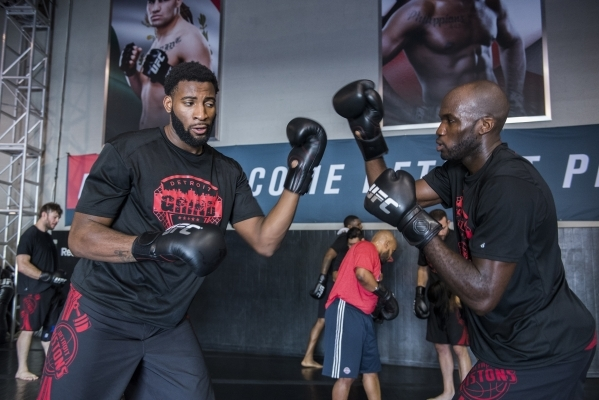 NBA basketball players Andre Drummond, left, and Joel Anthony of the Detroit Pistons do some MMA training at the UFC gym in Las Vegas on Wednesday, Sept. 2, 2015. (Martin S. Fuentes/Las Vegas Revi ...