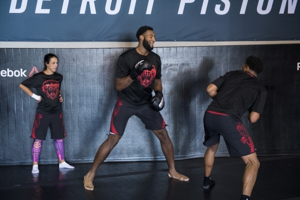 UFC womens strawweight champion Joanna Jedrzejczyk, left, holds a training session with NBA basketball players, from left, Andre Drummond and Darrun Hilliard of the Detroit Pistons at the UFC gym  ...