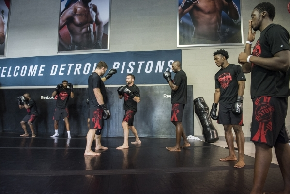 Former UFC fighter Forrest Griffin, third from left, holds a training session for NBA basketball players from the Detroit Pistons at the UFC gym in Las Vegas on Wednesday, Sept. 2, 2015. (Martin S ...
