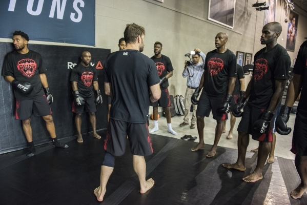 Former UFC fighter Forrest Griffin, center, holds a training session for NBA basketball players from the Detroit Pistons at the UFC gym in Las Vegas on Wednesday, Sept. 2, 2015. (Martin S. Fuentes ...