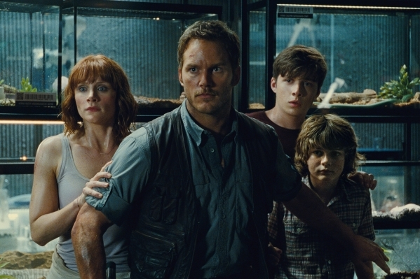 "(L to R) Claire (BRYCE DALLAS HOWARD), Owen (CHRIS PRATT), Zach (NICK ROBINSON) and Gray (TY SIMPKINS) watch in terror in ""Jurassic World"". Photo Credit: Universal Pictures and Amblin En ..."