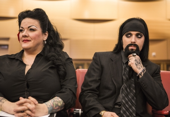 Street performers Renea' Le Roux, left, and Mannifred Yates, who has perform on  Fremont Street for six years, listens buskers ordinance hearing at Las Vegas City Council on Wednesday, Sept. ...