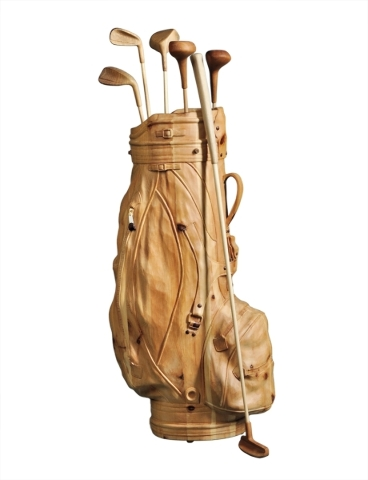 No, it's not a golf bag. It is a life-sized unpainted wood sculpture by a contemporary Italian artist. It sold at a Skinner auction, Skinnerinc.com, in Boston for $3,240. COWLES SYNDICATE