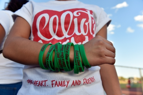 """Wrist bands that read """"Ellie's One Heart"""" are seen before the Las Vegas and Green Valley high schools' football game at Las Vegas High School on Friday, Sept. 4, 2015. Money  ..."""