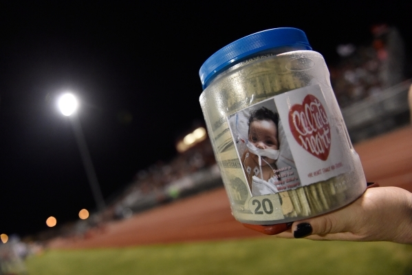 A jar of cash is seen during the Las Vegas and Green Valley high schools' football game at Las Vegas High School on Friday, Sept. 4, 2015. The money collected during the first half of the ga ...
