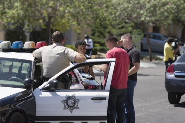 Las Vegas police investigate the scene where a man was found with a gunshot wound on Hunting Lodge Avenue, near the intersection of Windmill Lane and Rainbow Boulevard in Las Vegas Wednesday Sept. ...