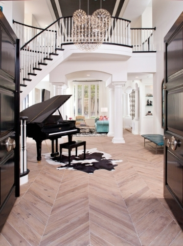 Here ceramic wood flooring is done in a chevron pattern. Photos: Courtesy of P. Scinta Designs LLC.