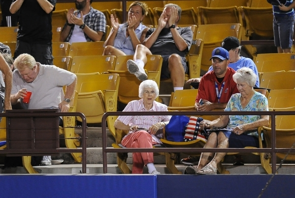 Eighty-five-year-old Phyllis Flaherty, center, who has had season tickets to 51s games for 32 years, watches during a Triple-A minor league baseball game between the Las Vegas 51s and El Paso Chih ...