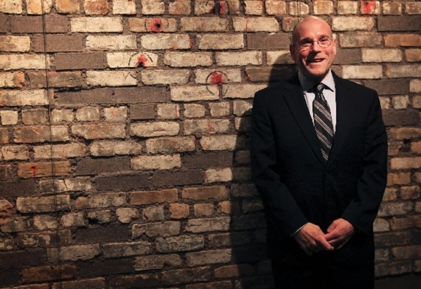 Executive Director Jonathan Ullman poses in front of the infamous St. Valentine?s Day Massacre wall at The Mob Museum, formally the National Museum of Organized Crime and Law Enforcement. Feb. 14, ...