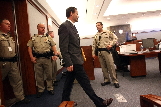 Former Las Vegas firefighter George Tiaffay walks into the courtroom before being found guilty of paying a homeless man to kill his wife during his trial at the Regional Justice Center Thursday, S ...