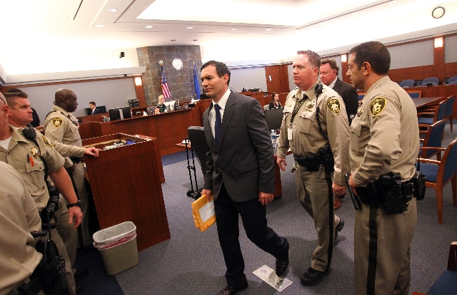 Former Las Vegas firefighter George Tiaffay walks out of the courtroom before being found guilty of paying a homeless man to kill his wife during his trial at the Regional Justice Center Thursday, ...