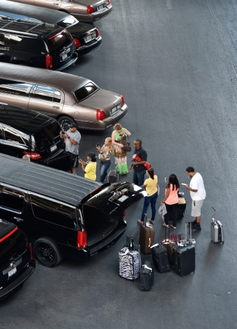 Travelers line up to get into their limousine at McCarran International Airport on Friday, Sept. 4, 2015, in Las Vegas. (David Becker/Las Vegas Review-Journal)