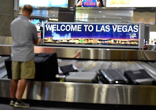 An arriving passenger waits to collects his luggage at McCarran International Airport on Friday, Sept. 4, 2015, in Las Vegas. (David Becker/Las Vegas Review-Journal)