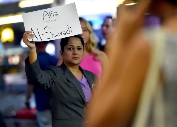 A limousine driver displays a sign for her arriving passenger at McCarran International Airport on Friday, Sept. 4, 2015, in Las Vegas. (David Becker/Las Vegas Review-Journal)