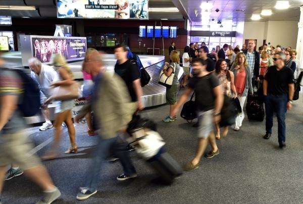 Passengers arrive at the baggage claim area at McCarran International Airport on Friday, Sept. 4, 2015, in Las Vegas. (David Becker/Las Vegas Review-Journal)