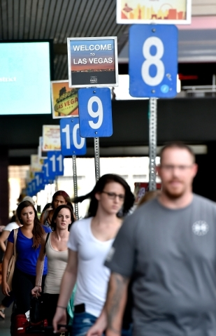 Arriving tourists walk to the taxi cab stalls at McCarran International Airport on Friday, Sept. 4, 2015, in Las Vegas. (David Becker/Las Vegas Review-Journal)