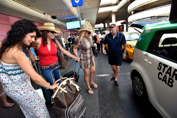 Tourists from San Diego load into a taxi cab at McCarran International Airport on Friday, Sept. 4, 2015, in Las Vegas. (David Becker/Las Vegas Review-Journal)